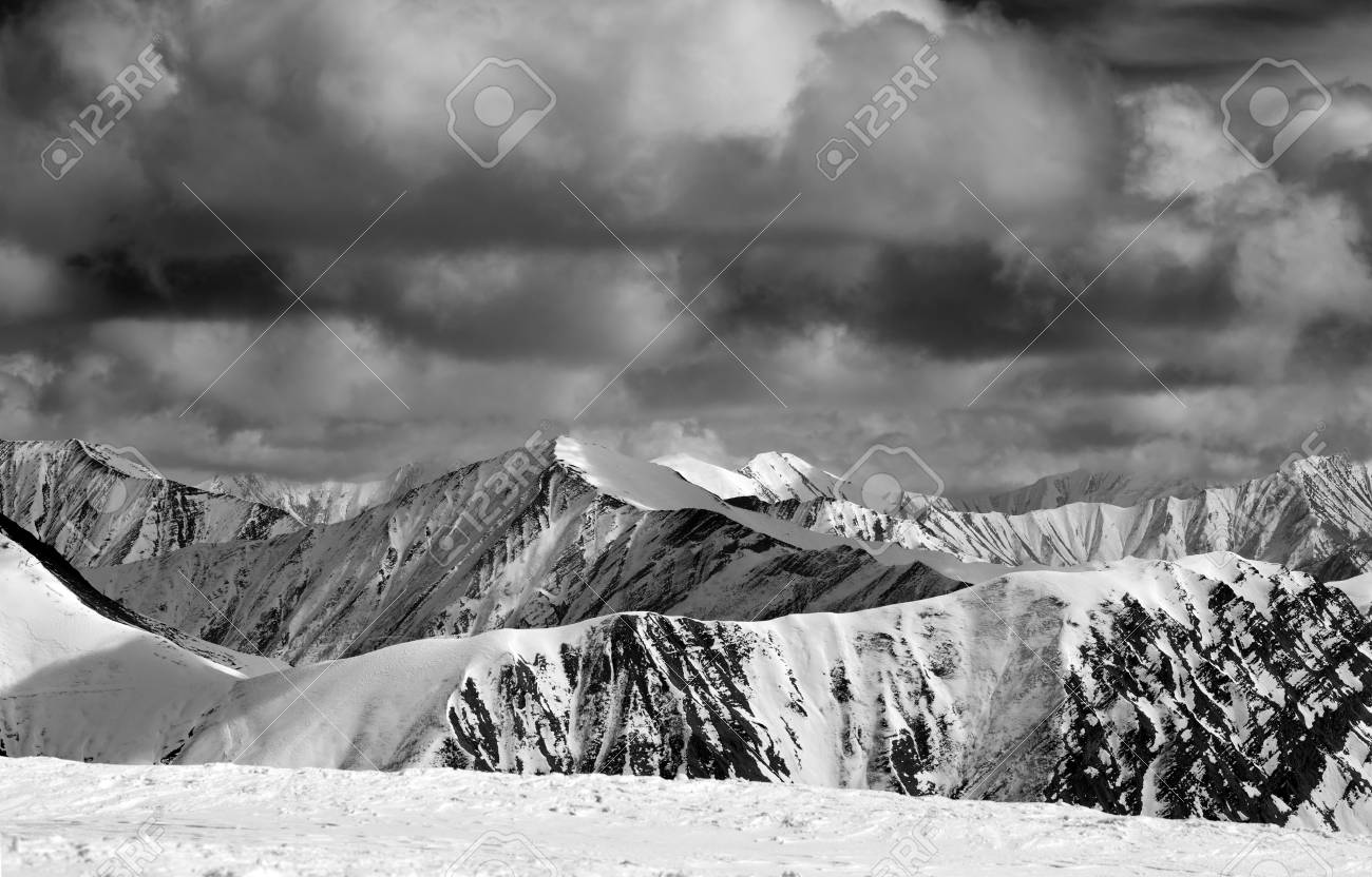 Black and white winter snow mountains in storm clouds caucasus