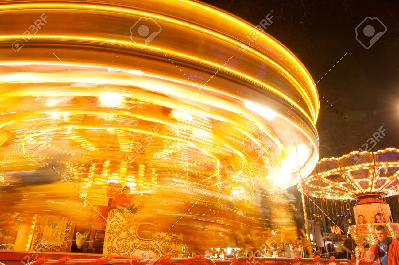 Roundabout at a fair in London, with traditional animal mounts, barley twist poles and fairy lights, 5 December 2009 Stock Photo - 6096330