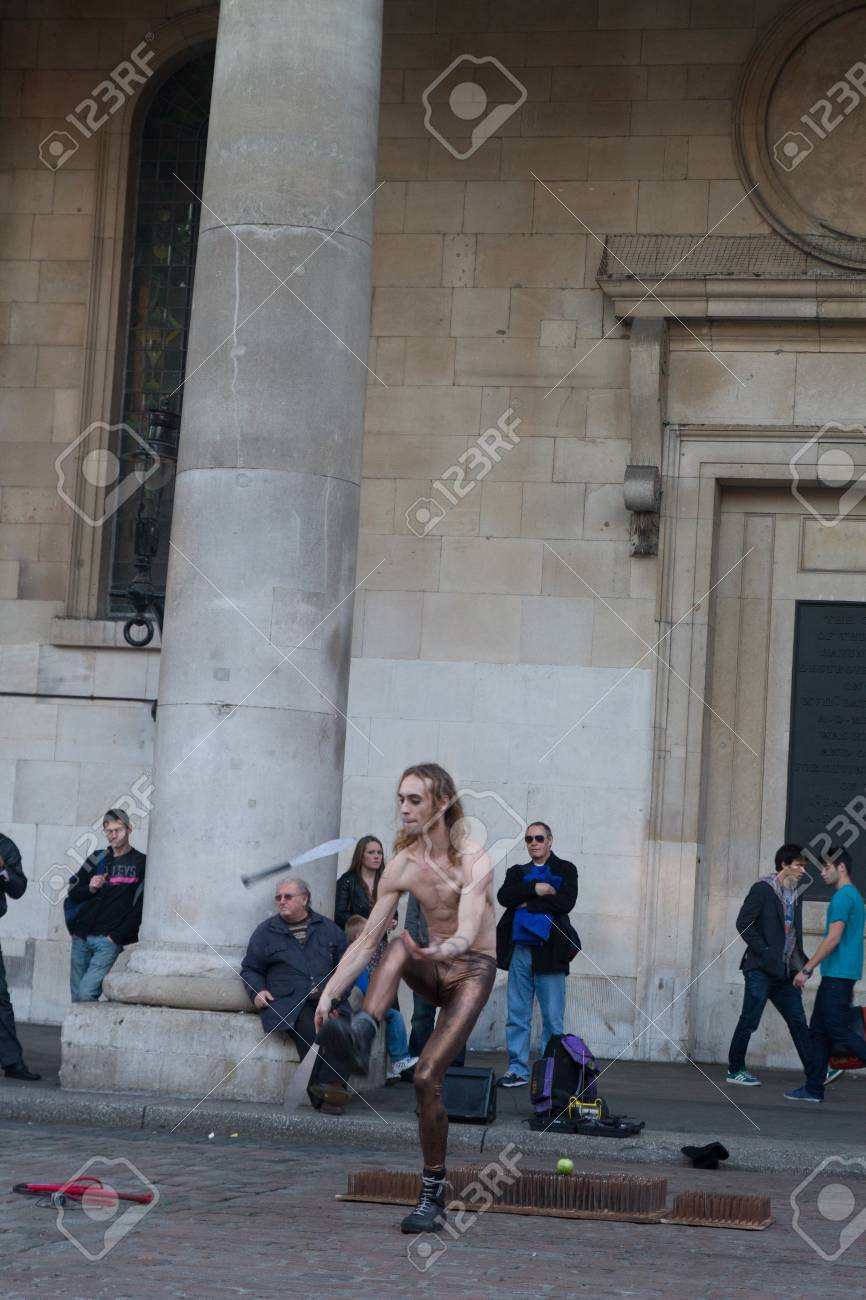 A street performer in front of Covent Garden market, London, UK, Sunday, November 13, 2011. Stock Photo - 11828500