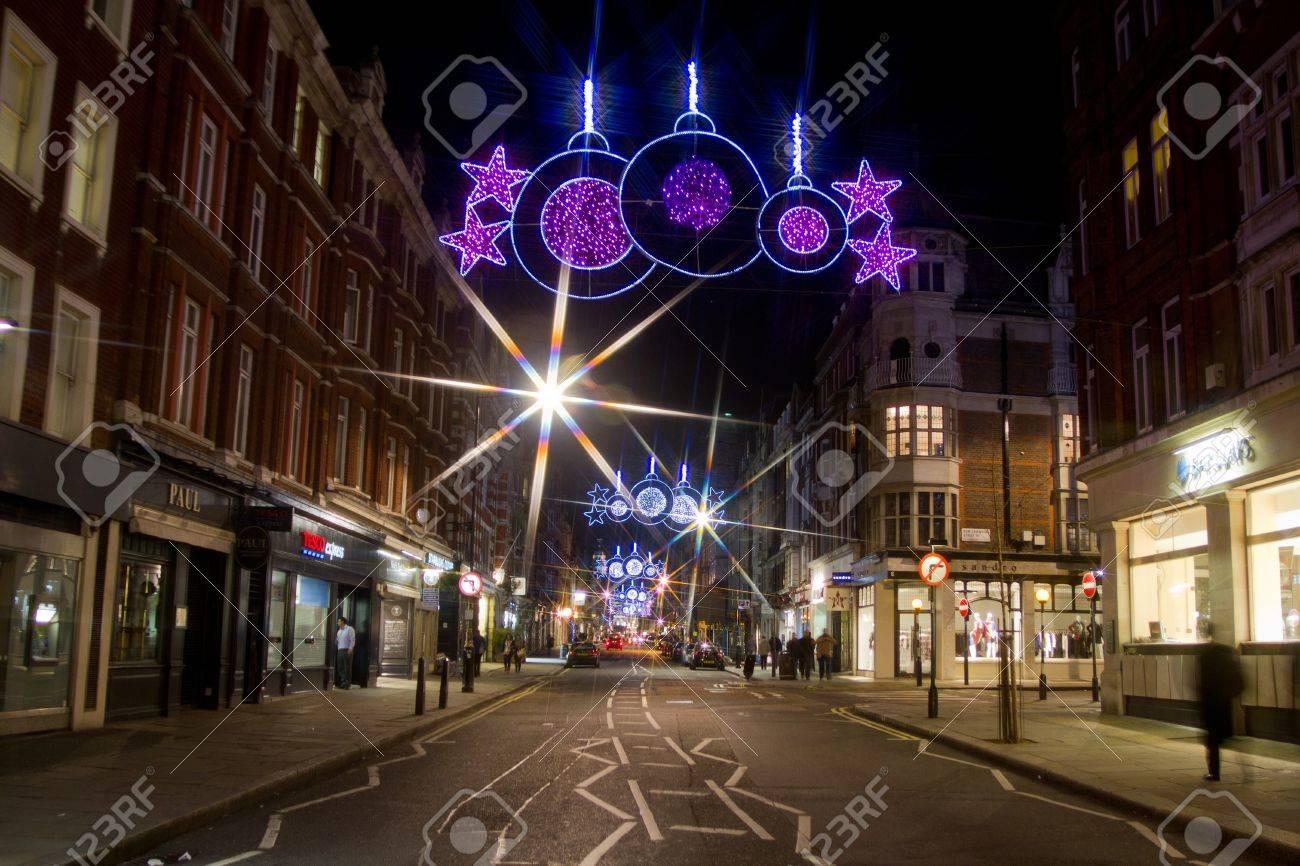 Christmas street lights and traffic by night on Marylebone Street, London, UK on 06 December 2011 Stock Photo - 11828227
