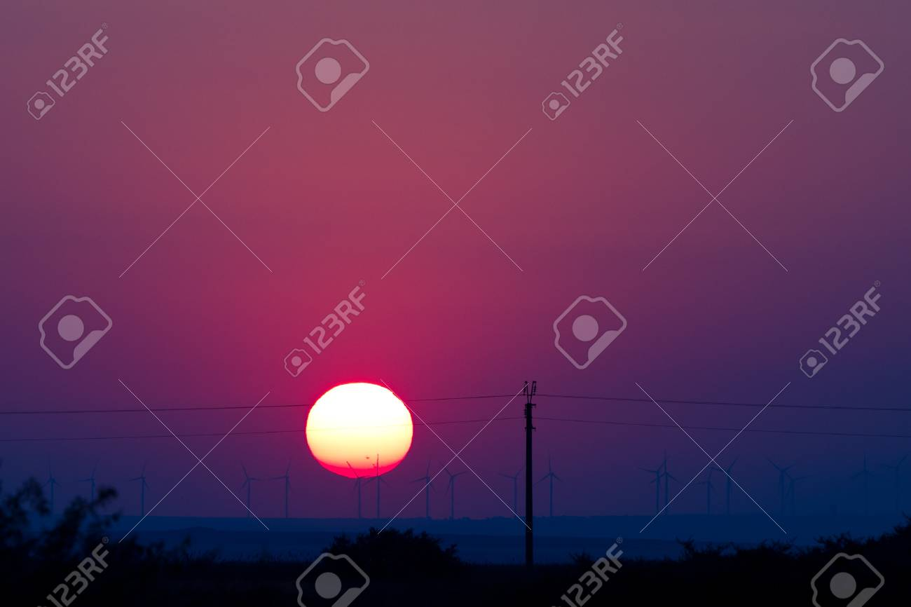 Sunset and windmills by the Black Sea Stock Photo - 14487078
