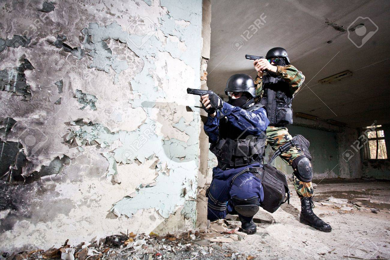 The two armed soldiers in a camouflage costs in alertness Stock Photo - 3925657
