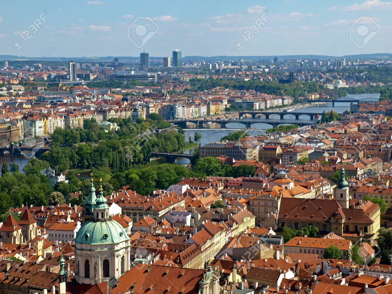 The view from the bell tower of the Cathedral of St. Vitus on the south-east - Vltava river, bridges Legia, Jirasek, Palacky, dancing house. Red tiled roofs, modern high-rise buildings, river, bridges, green parks. Stock Photo - 18145004