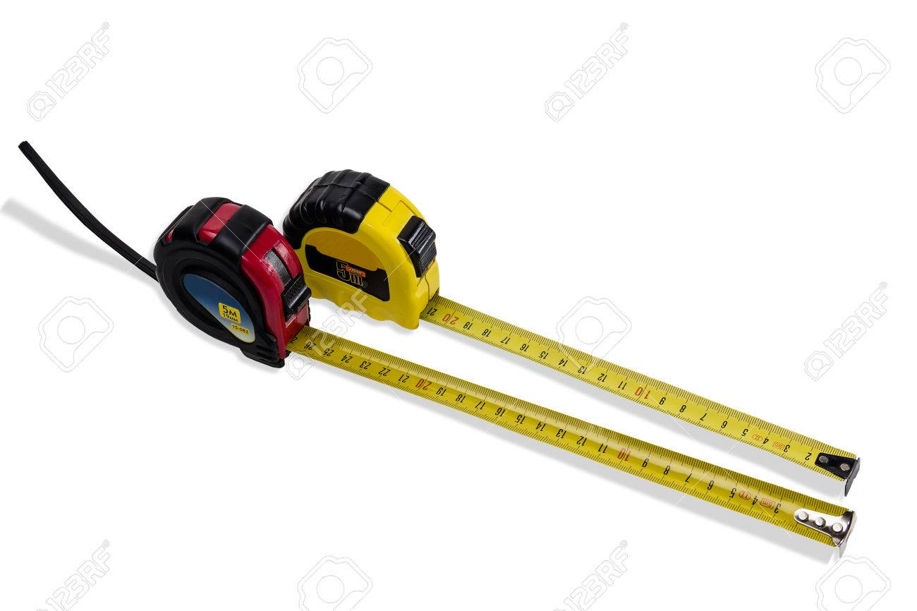 Two tape measure in a red and yellow case to measurement in the stock photo two tape measure in a red and yellow case to measurement in the metric system with partially pulled out yellow tape on light background aloadofball Images