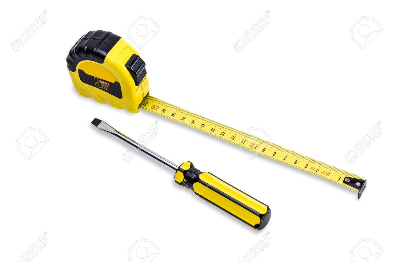 Yellow tape measure to measure the dimensions of the metric system stock photo yellow tape measure to measure the dimensions of the metric system and flat screwdriver with a yellow handle on light background isolation aloadofball Images