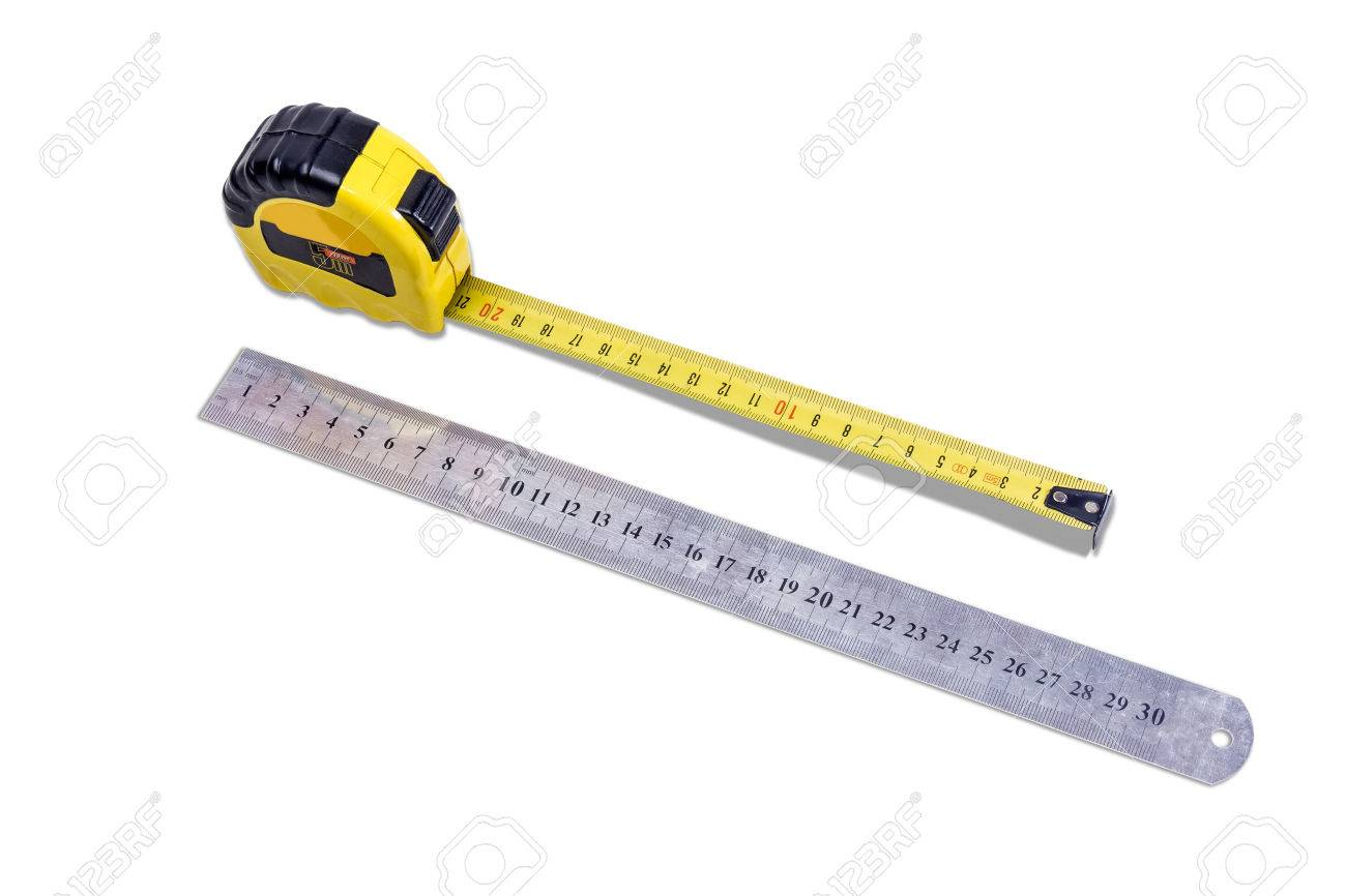 yellow tape measure and metal ruler to measure the dimensions of the metric system on light