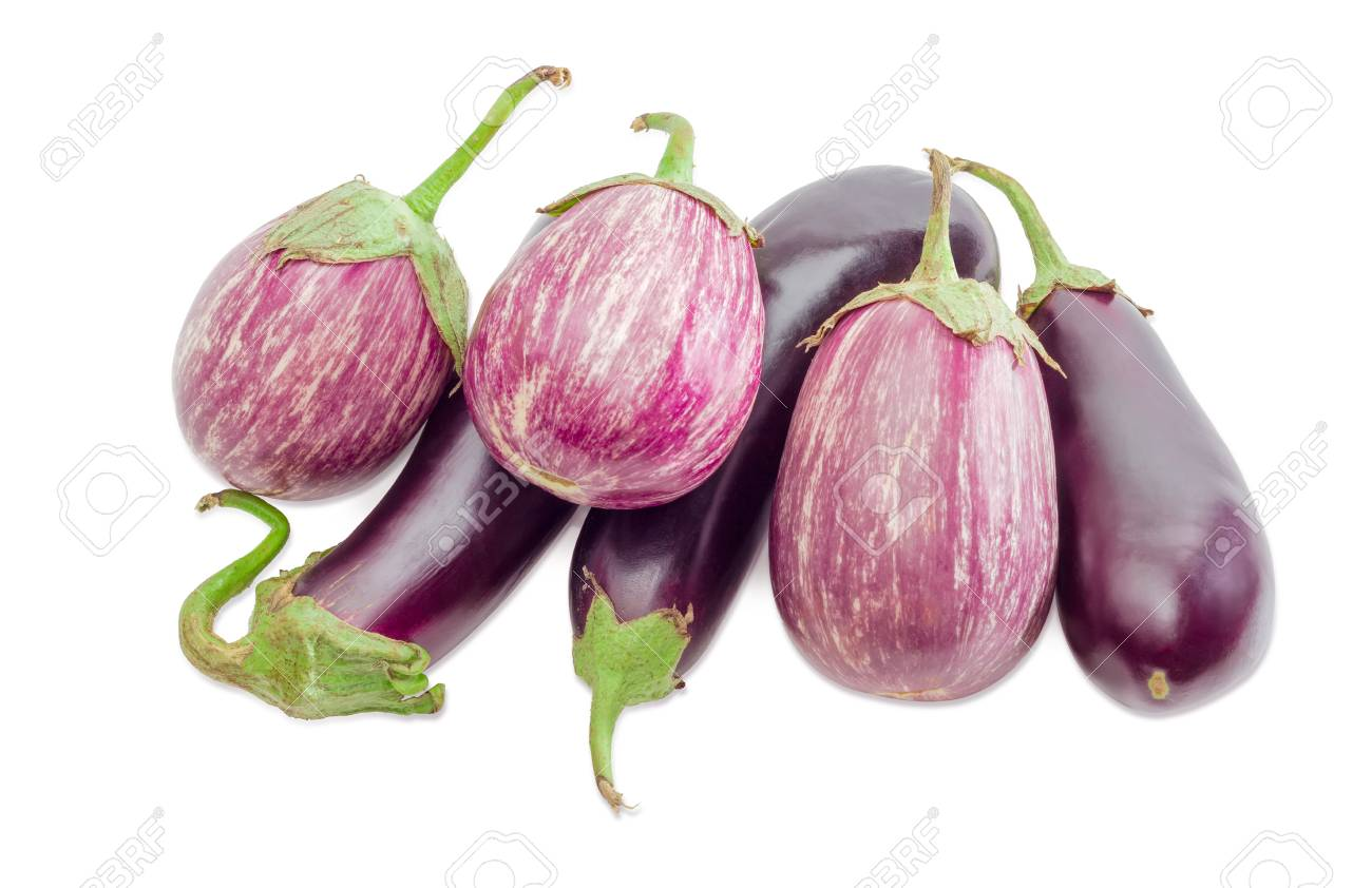 Pile of the conventional purple eggplants and graffiti eggplants on a light background stock photo
