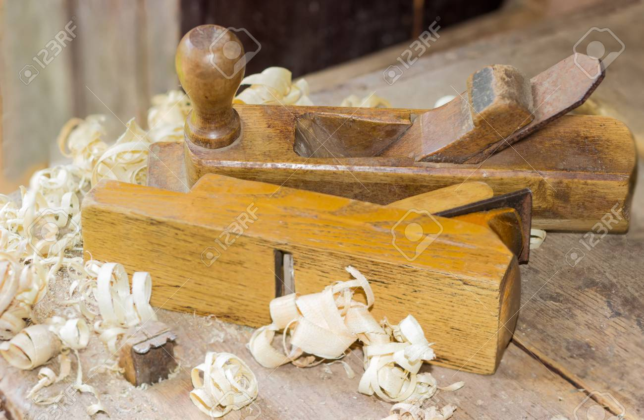 Two Old Wooden Hand Planes Different Purposes Among A Shavings