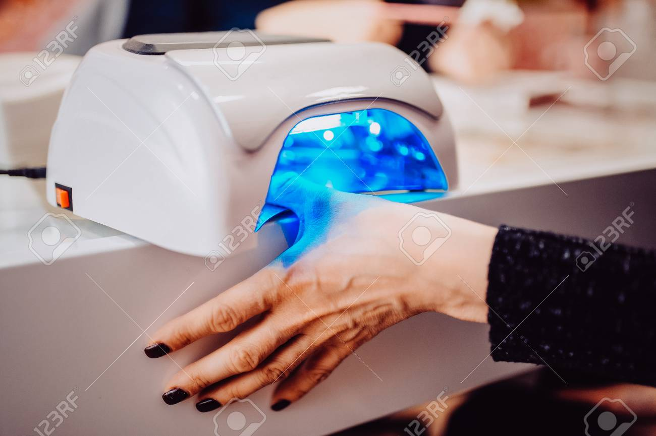 UV Lamp To Fix The Gel Coat On Nails. The Client Dries The Hand ...