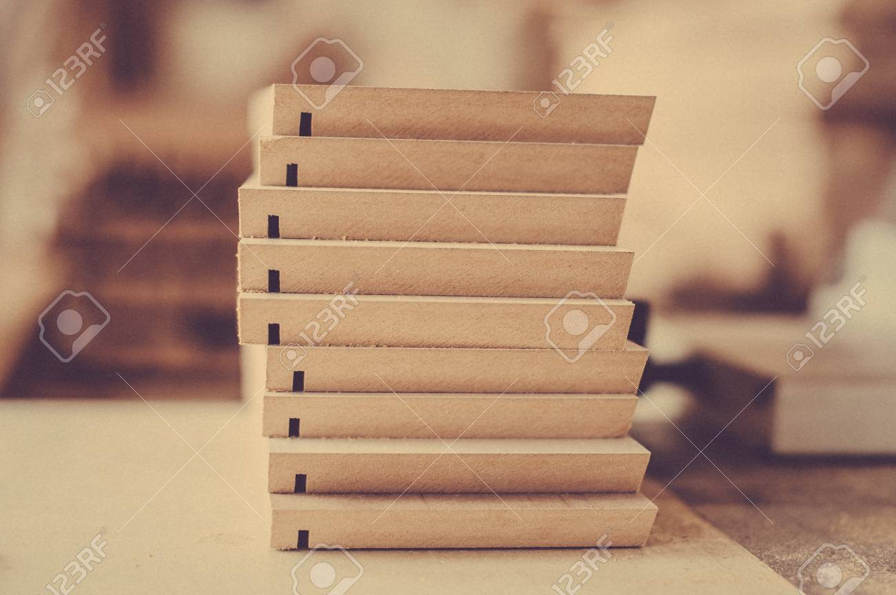 A Stack Of Wooden Furniture Items On The Table Toned Image Stock