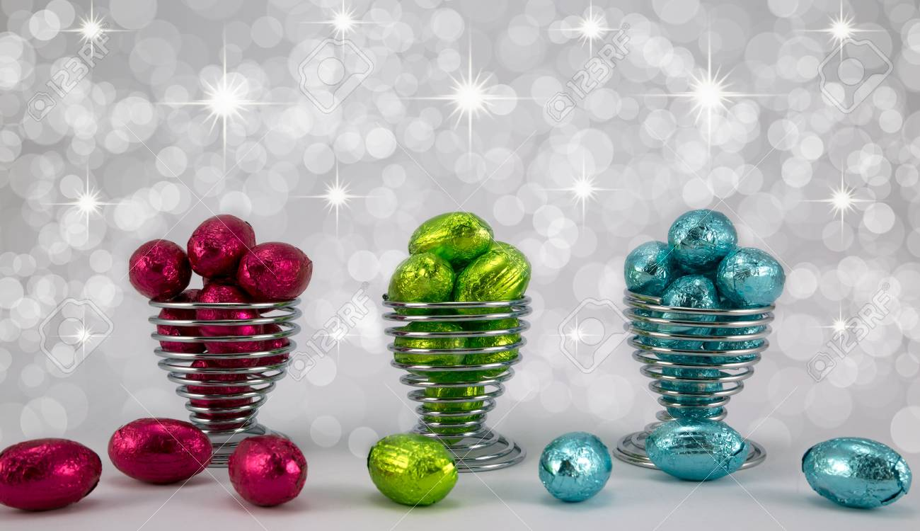 Brightly Coloured Easter Eggs In Wire Eggcups. Stock Photo, Picture ...