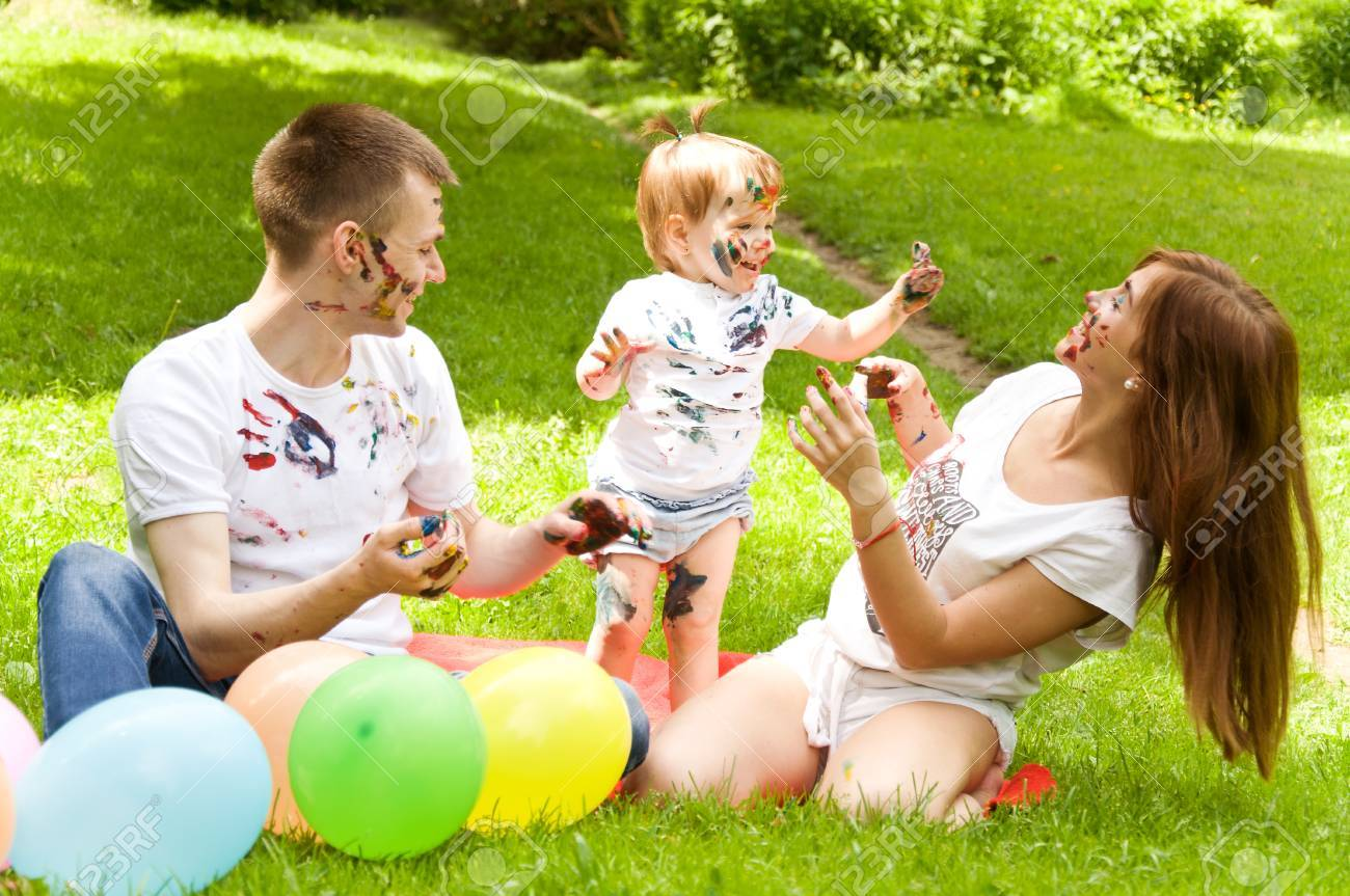 Family Fun Is Resting In Nature. Paint Colors Each Other Stock Photo ...