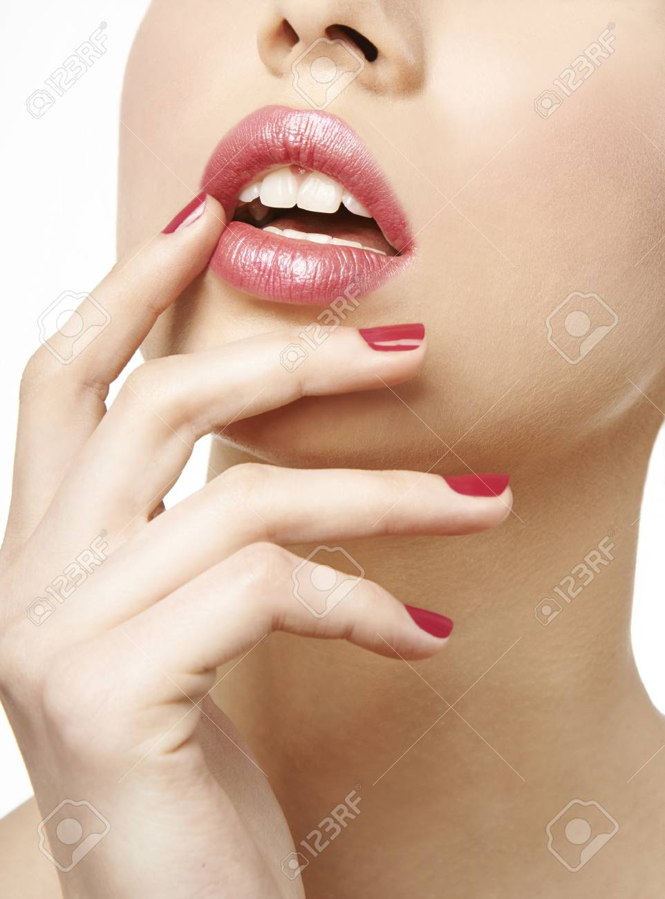 Woman Close Up With Pink Glossy Lipstick And Red Nail Polish Stock ...