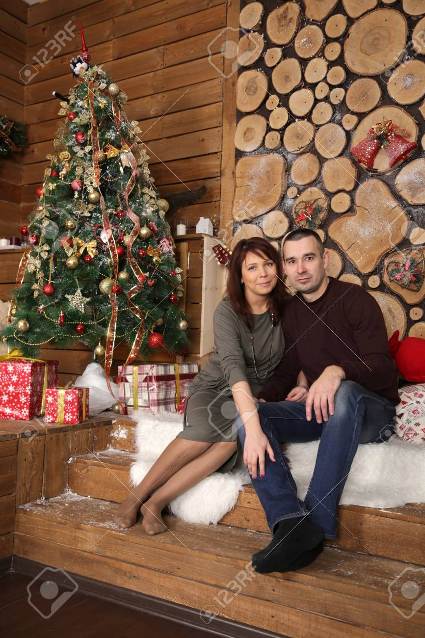 Delightful Christmas Gifts For Married Couples Young Part - 2: Stock Photo - Young Married Couple At A Christmas Tree With Gifts, Portrait  In A Beautiful Festive Interior