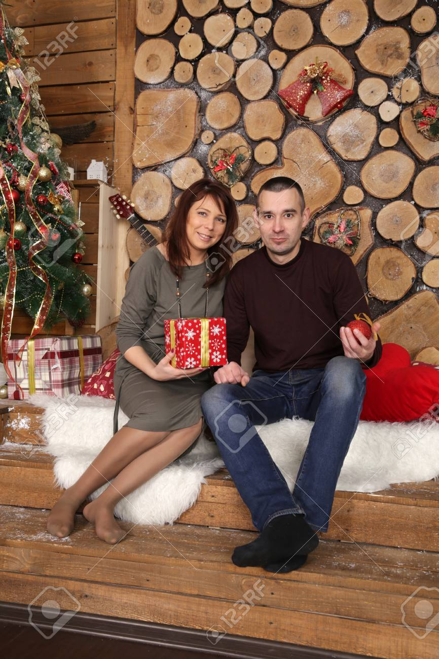 stock photo young married couple at a christmas tree with gifts portrait in a beautiful festive interior