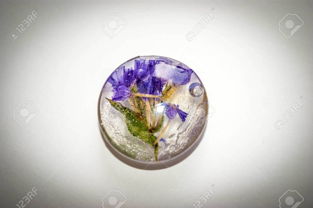 Soft blue vintage toned dried flowers Limonium in a crystal