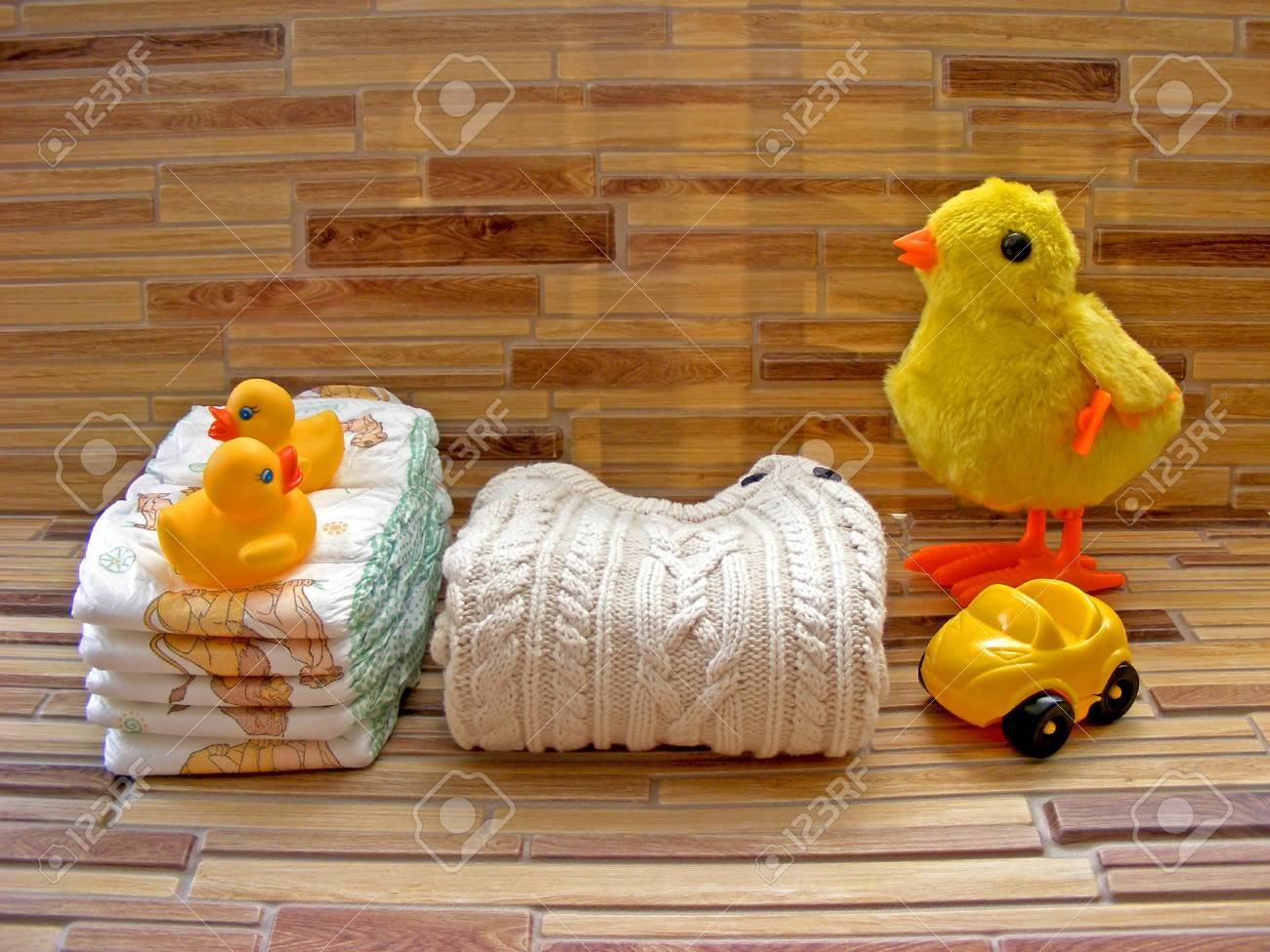 Diapers Toy Sets For Child, Stacking Diapers On A Bamboo Background ...