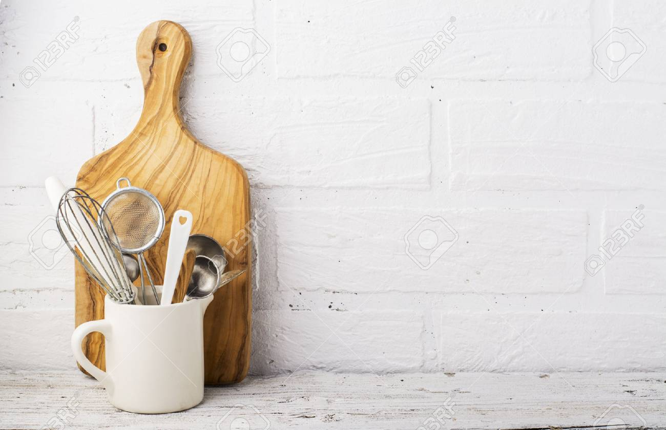 Kitchen Tools Olive Cutting Board On A Shelf Against White Stock Photo Picture And Royalty Free Image Image 68834912