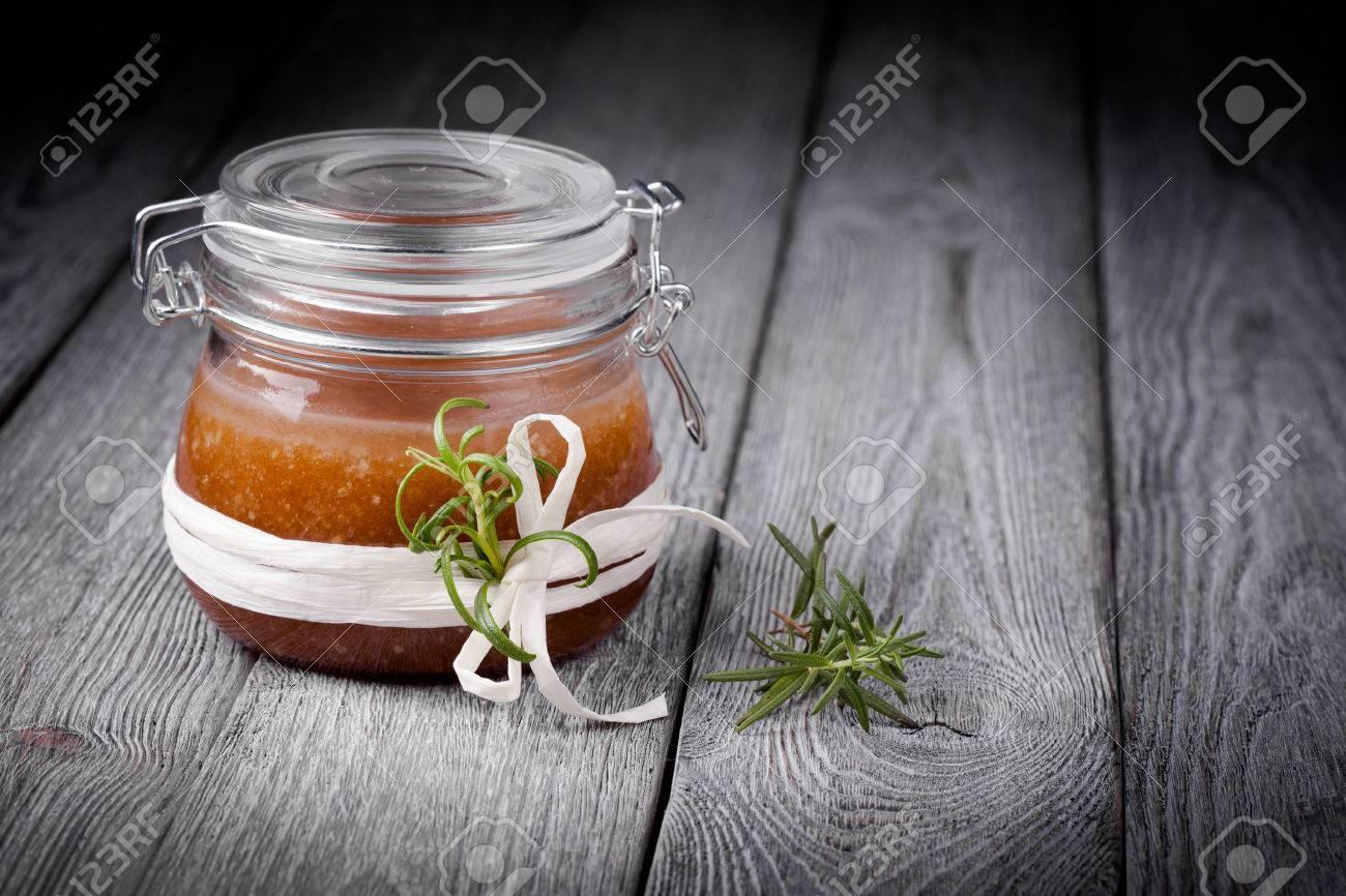 Handmade DIY natural sugar and salt body scrub with ginger, rosemary,