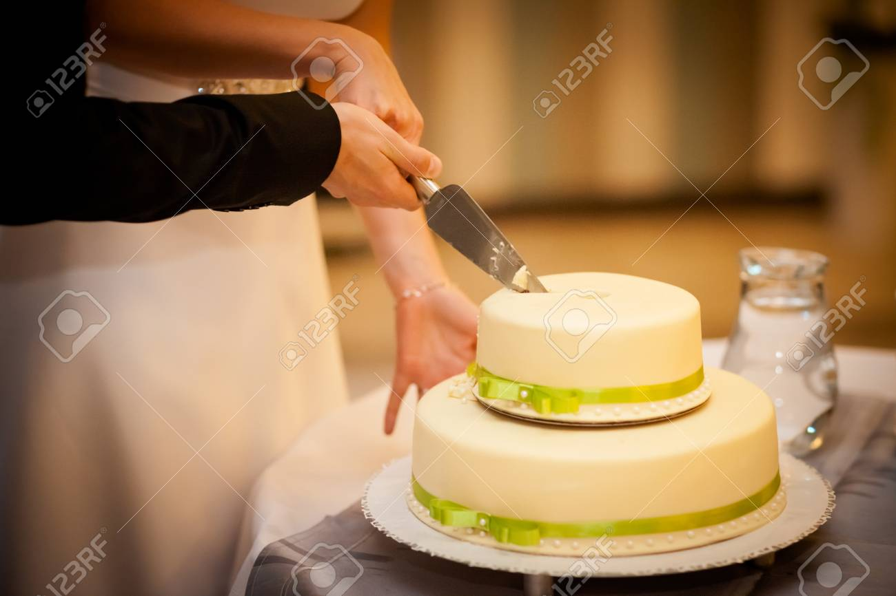 Beautiful Wedding Cake Detail. Traditional First Slice Cutting ...