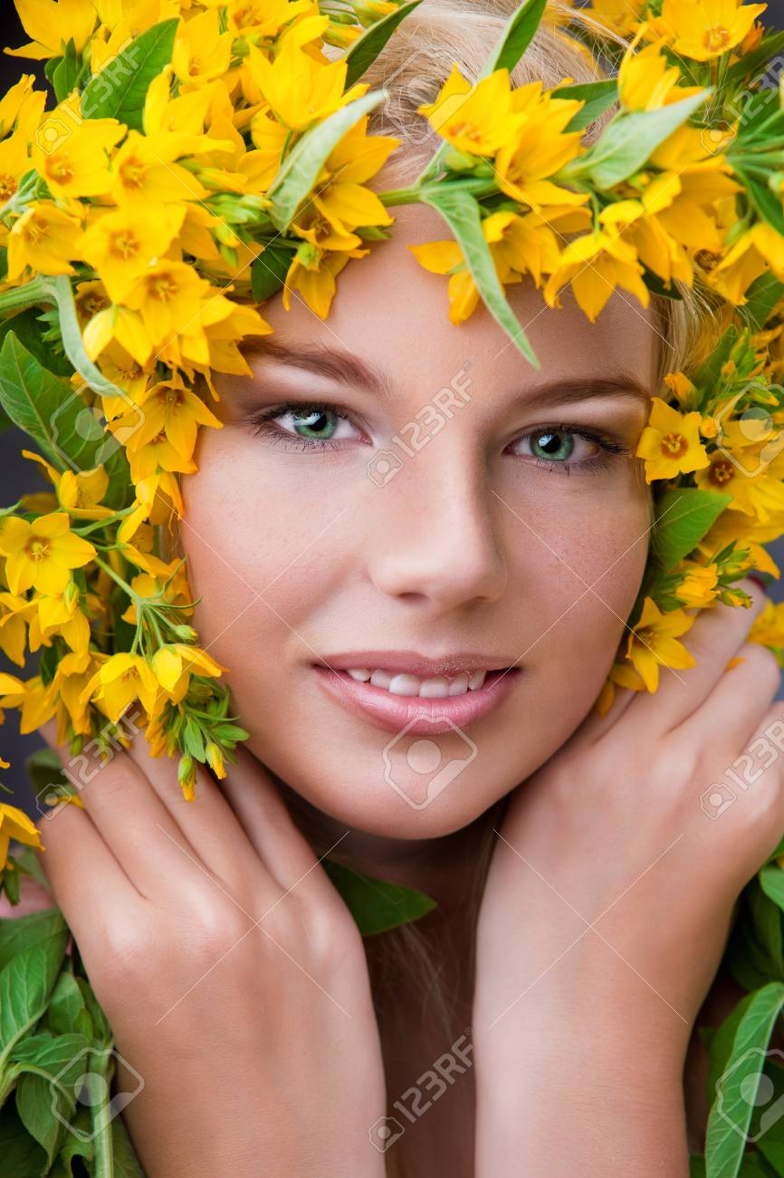 Close-up shot of young beautiful girl with flowers Stock Photo - 16334005