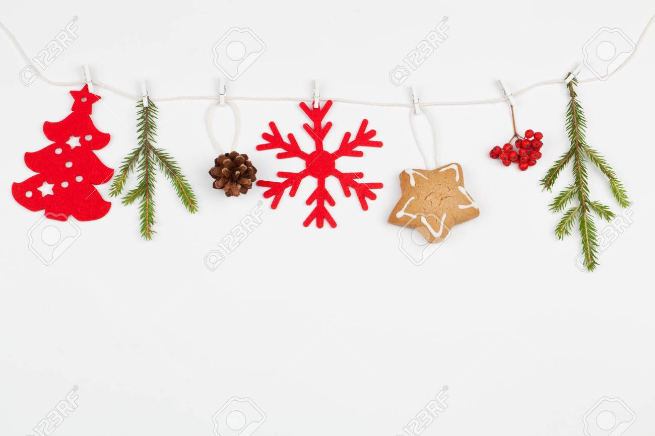 pretty nice 468e2 4b1f1 Christmas composition. on white rope red decoration, fir tree..