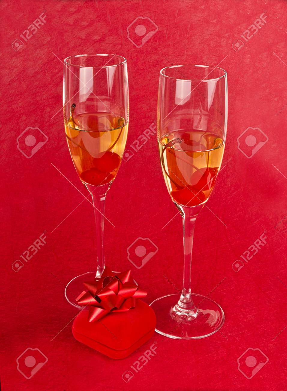 Two Valentine s champagne glasses with jewelery on white background Stock Photo - 17197549