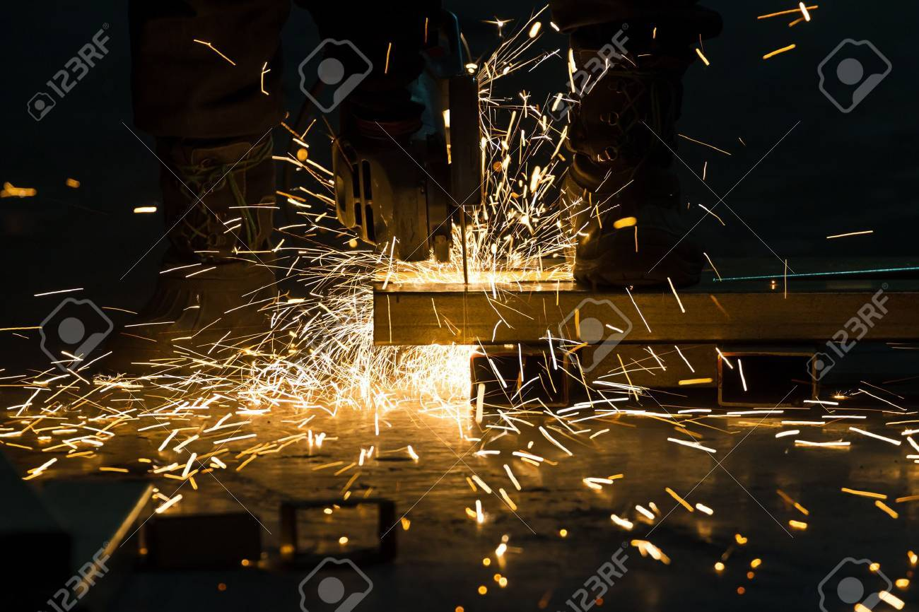 sharpening and cutting of iron by abrasive disk machine Stock Photo - 20209410