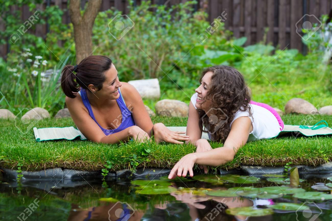 Two beautiful young brunet woman outdoors Stock Photo - 22306575