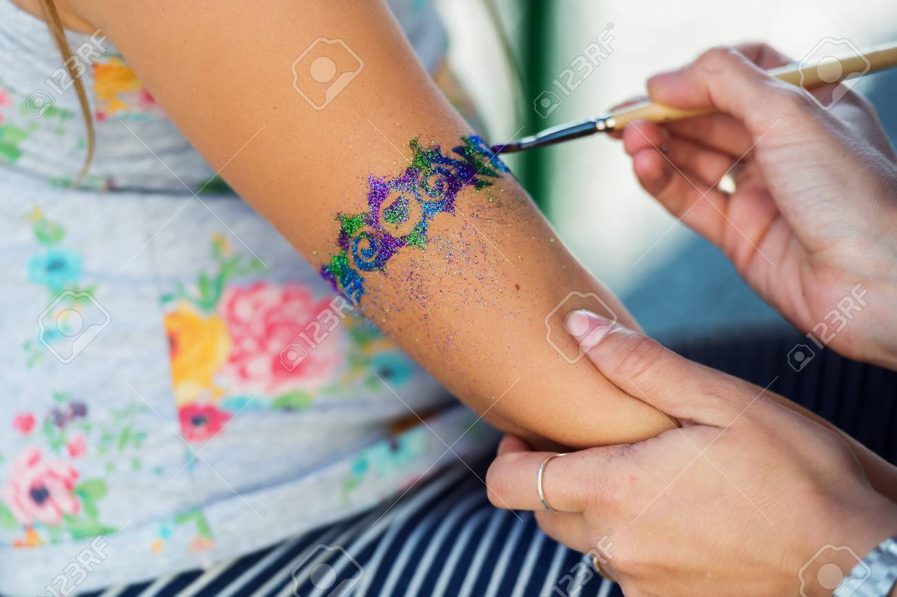 Little Girl Getting Glitter Tattoo At Birthday Party Stock Photo ...