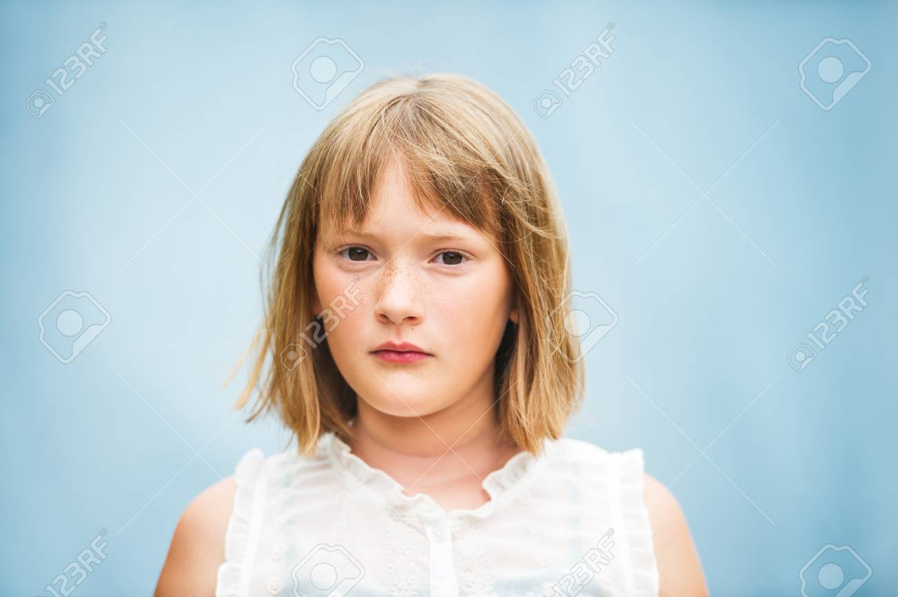 Close Up Portrait Of Adorable Little Girl With Short Bob Haircut