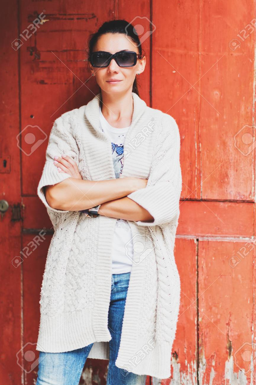 Outdoor Portrait Of Beautiful Stylish 40 Year Old Woman Wearing