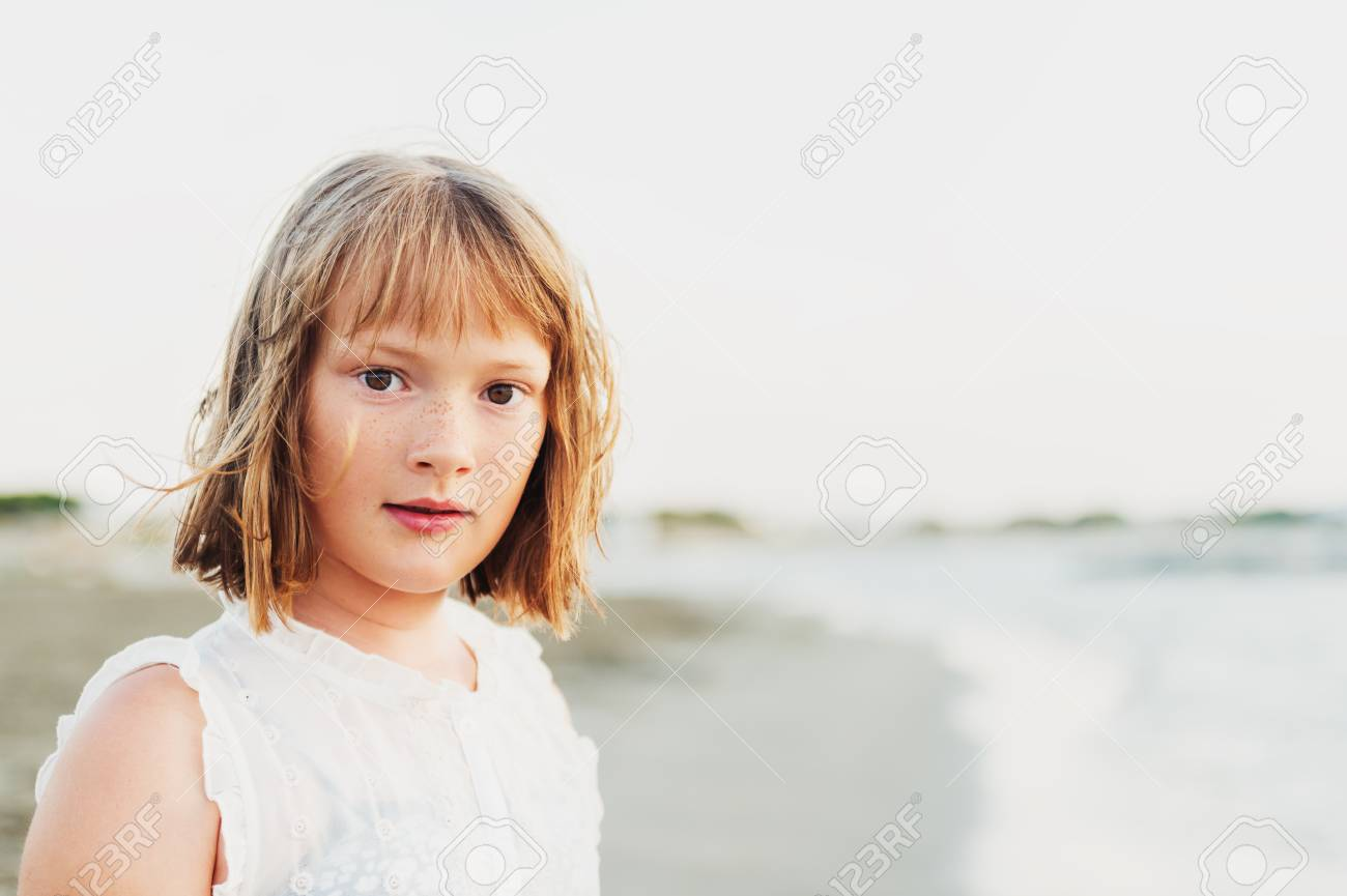 Close Up Portrait Of Sweet Little Girl With Short Bob Haircut