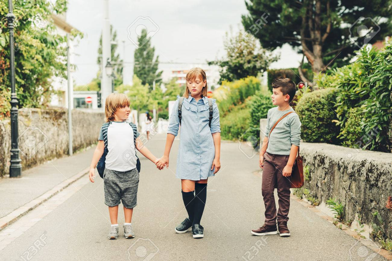 9fa509b57f Cute kids with backpacks walking back to school Stock Photo - 85035550