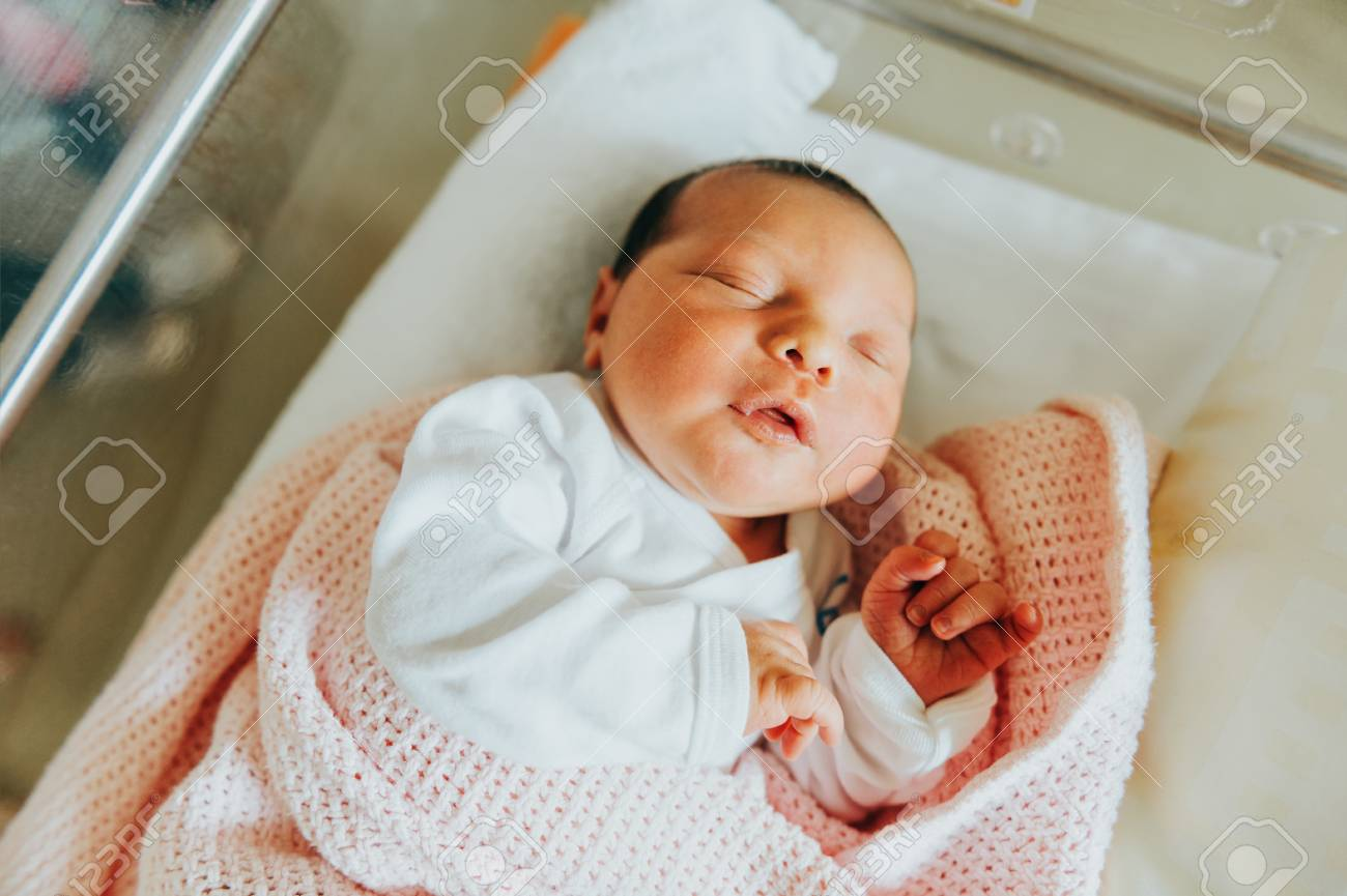 Close up portrait of newborn one day old baby in hospitals cradle stock photo 88786427
