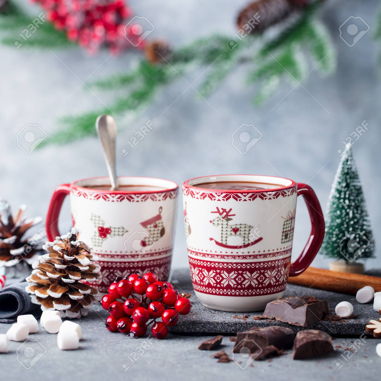 Christmas Mugs.Hot Chocolate With Marshmallows In Christmas Mugs On Grey Background