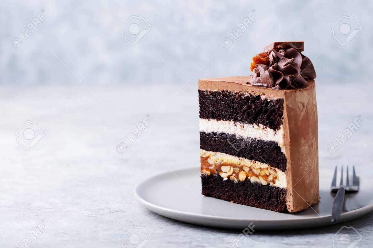 Chocolate, caramel, peanut cake, snickers on a plate - 123097419