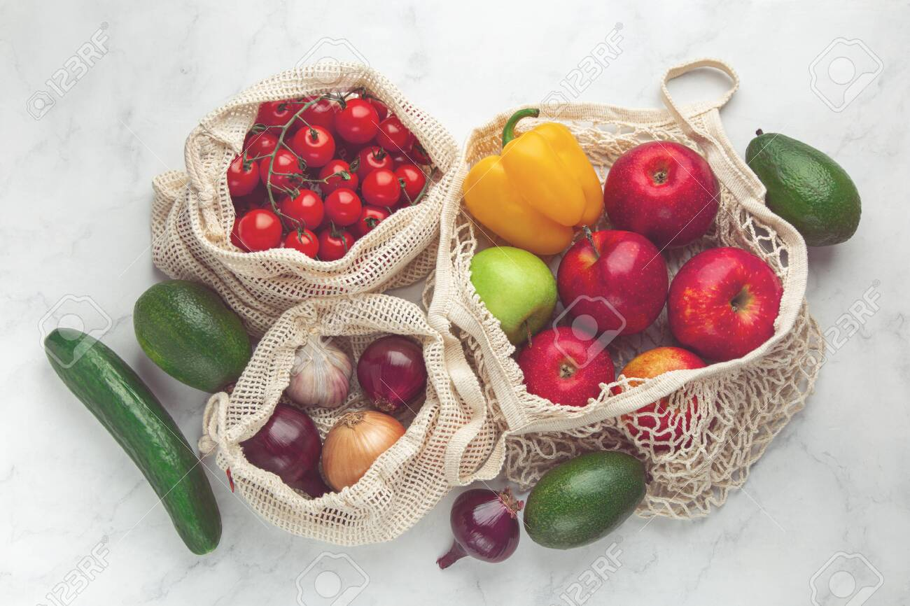 Zero waste and eco-friendly concept. Fresh organic fruits and vegetables in reusable textile shopping bags. top view, toned - 151319957
