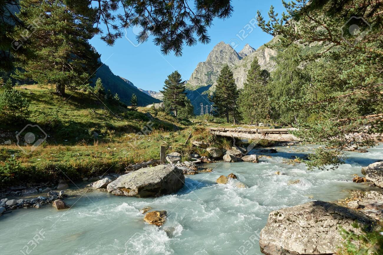 Mountain river landscape. Alps. In the morning in clear sunny day on a wide corner. The river quickly flows. Mountaineering and hikes. Amazing. Around. - 146474556