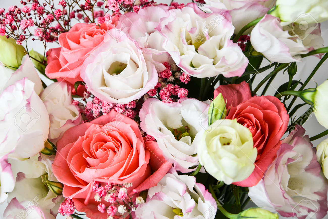 bouquet of pink and white roses and different flowers. close up, selective focus, background for Valentine's Day decoration. flower background. holiday greeting card - 155853329
