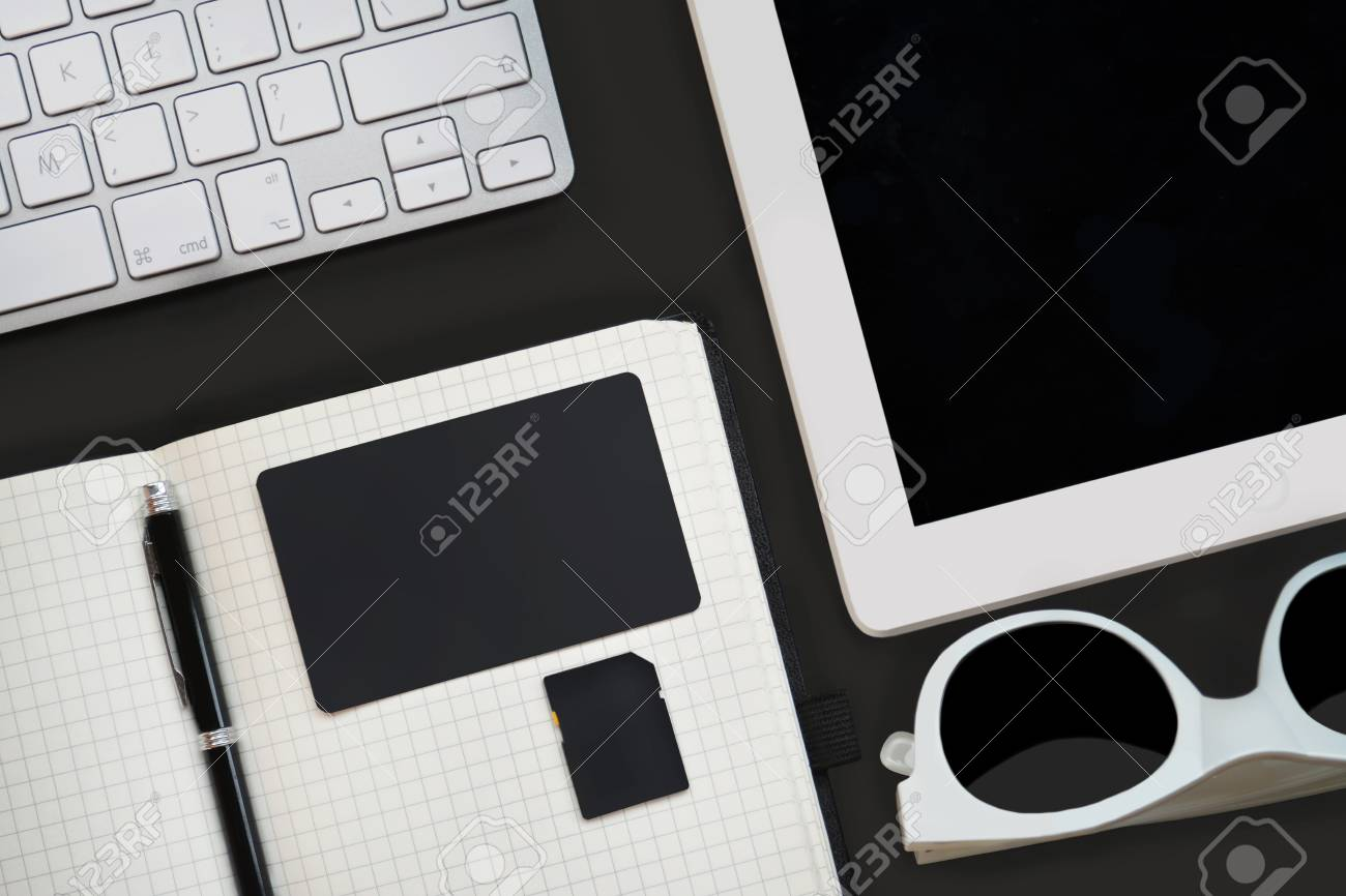 Workplace with open cell notebook white tablet keyboard workplace with open cell notebook white tablet keyboard sunglasses memory and business colourmoves Gallery