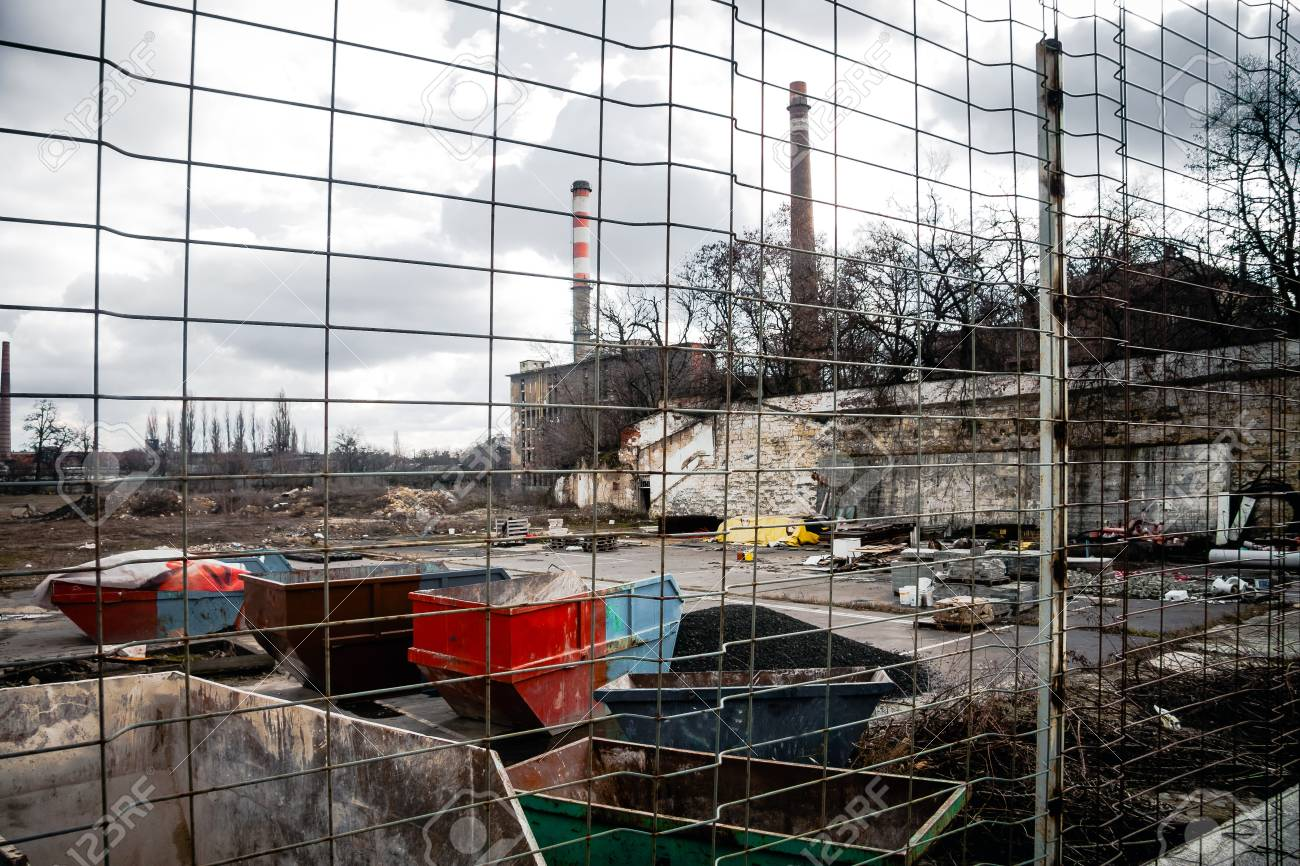 Industrial waste dump outdoors protected with fence Stock Photo - 18393477