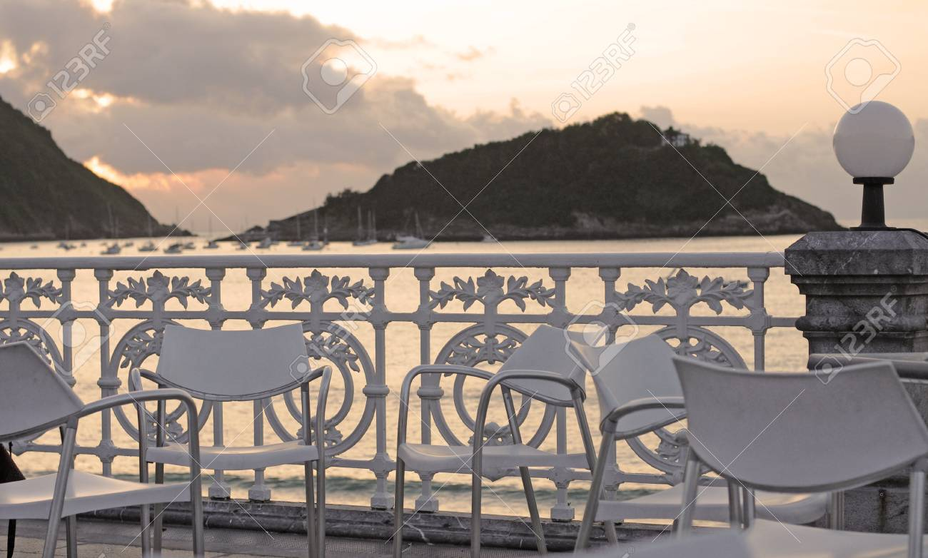 Modern Chairs By The Antique Wrought Iron Fence At The Beach Stock Photo Picture And Royalty Free Image Image 95590842