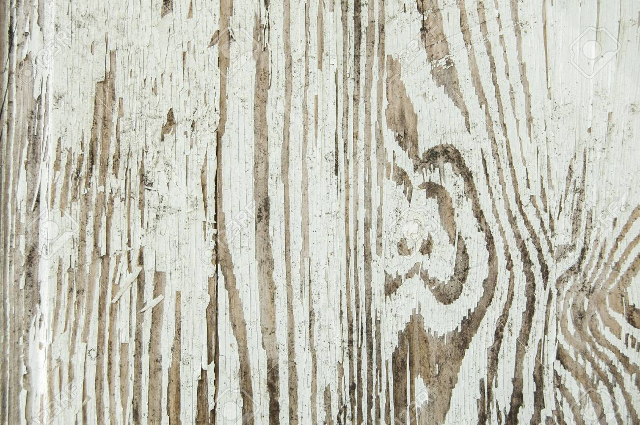 Cracked paint on a wooden wall. White color - 91376406