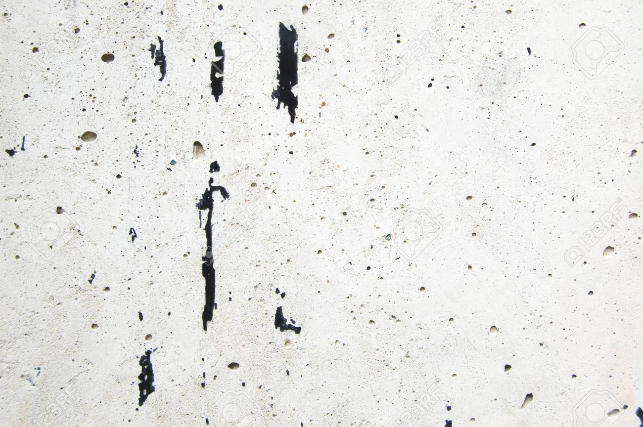 Black paint traces on white cement background - 91980848