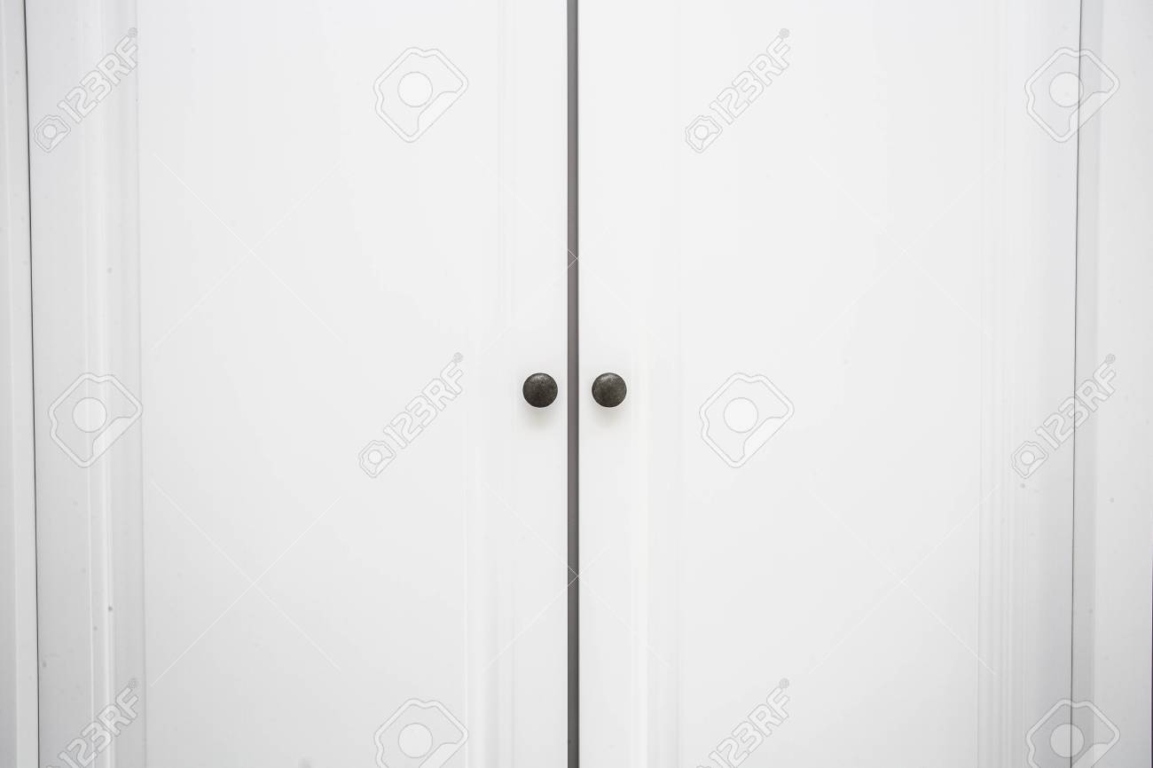White Wooden Closet Doors Close Up Background Texture Stock Photo