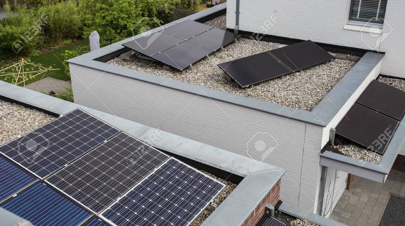 Modern houses with solar panels on the roof for alternative energy