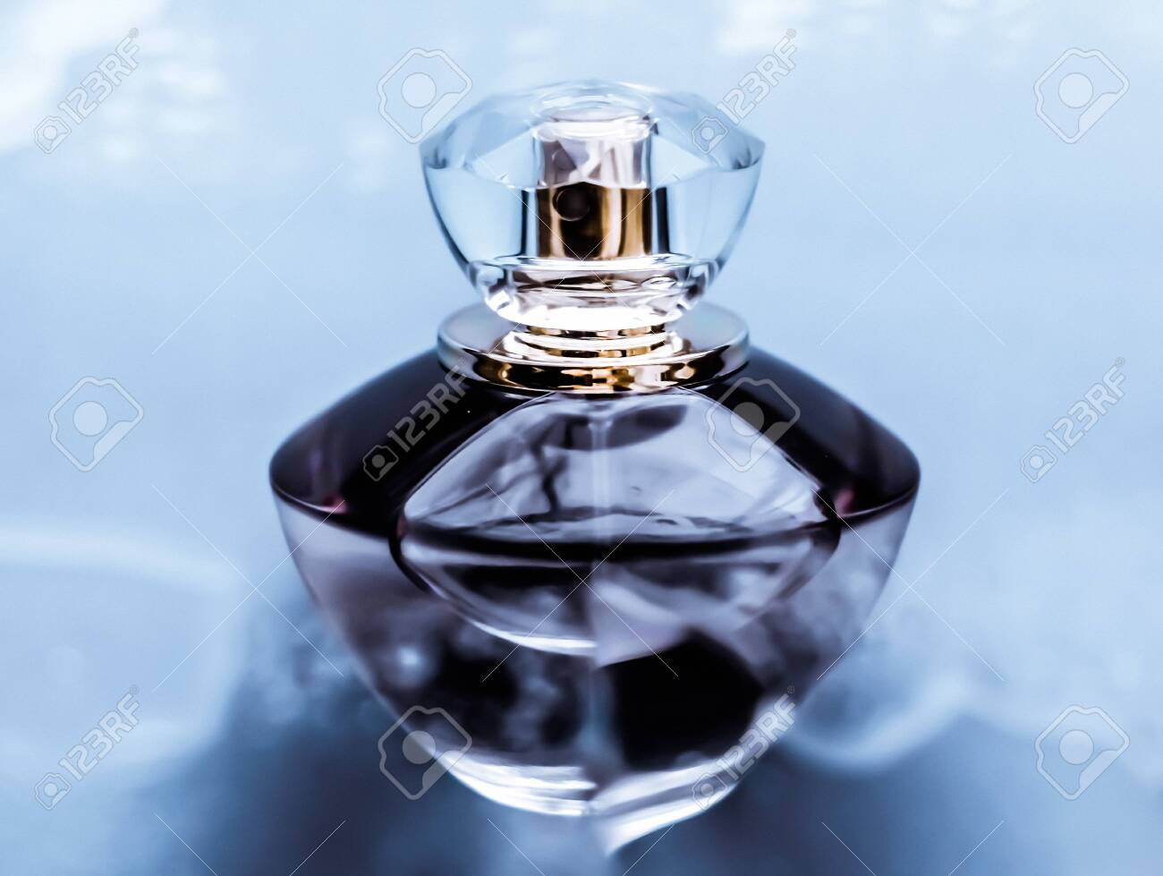 Perfumery, cosmetics and branding concept - Perfume bottle under blue water, fresh sea coastal scent as glamour fragrance and eau de parfum product as holiday gift, luxury beauty spa brand present - 134346463