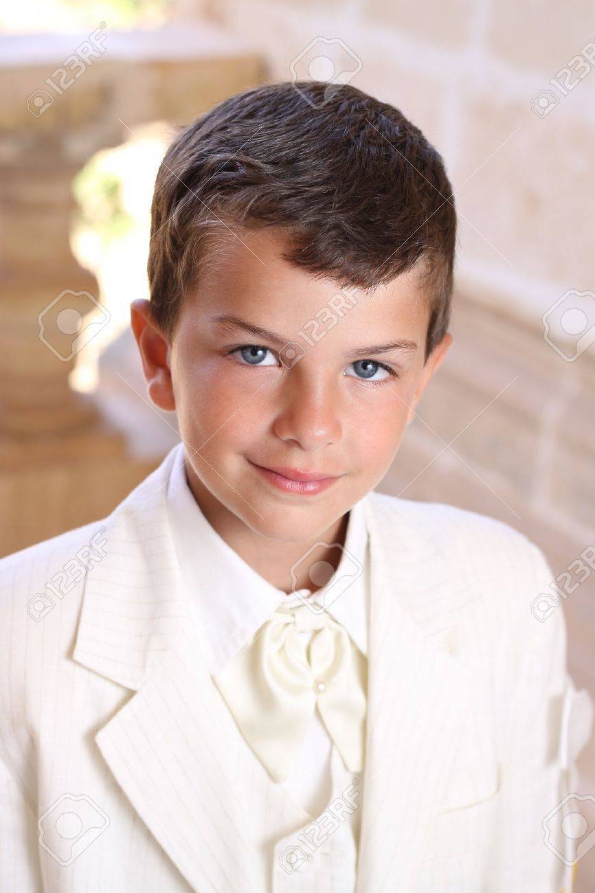 Portrait Of Boy Doing His Holy Communion Dressed In White Wedding ...