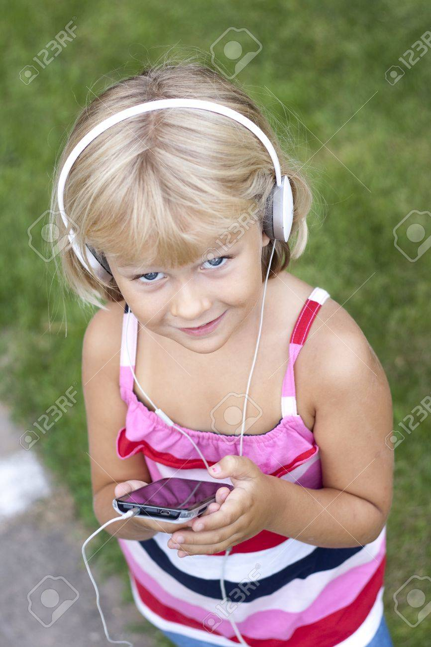 A young girl with mobile Stock Photo - 17261039